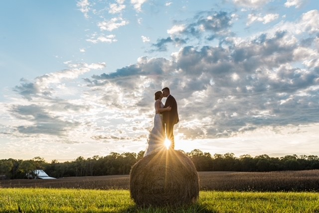 couple on top of hay bale