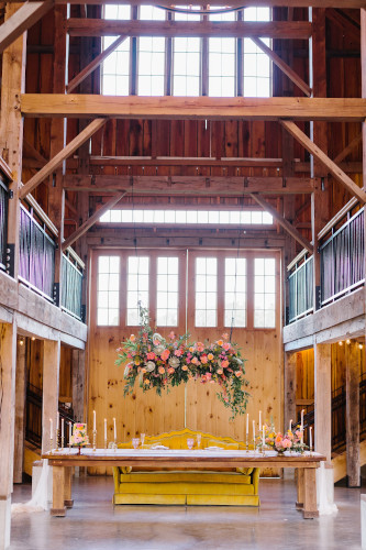 inside barn with hanging flowers