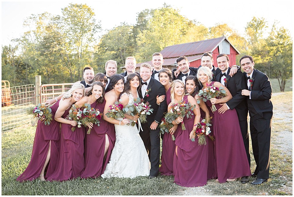 wedding party in front of field